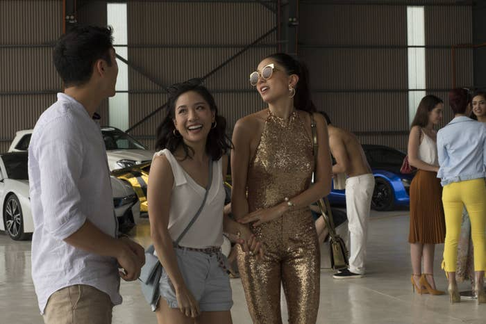 Henry Golding as Nick Young, Constance Wu as Rachel Chu, and Sonoya Mizuno as Araminta Lee in Crazy Rich Asians.