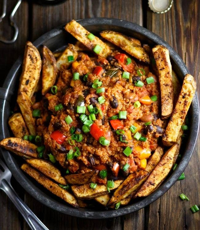 Oven-baked fries topped with a hearty quinoa chili — what could be better? Get the recipe.