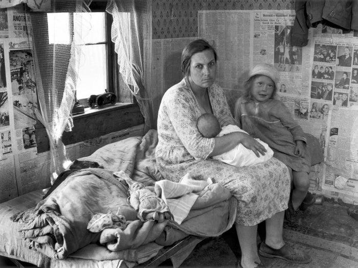 """Interior of Ozark cabin housing six people,"" Carl Mydans, Missouri, May 1936."