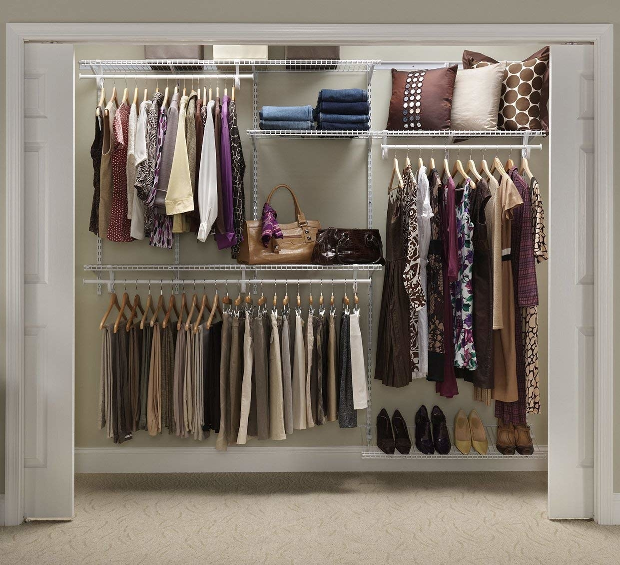 Organized closet with neatly-arranged hanging clothes, shoes, and bags