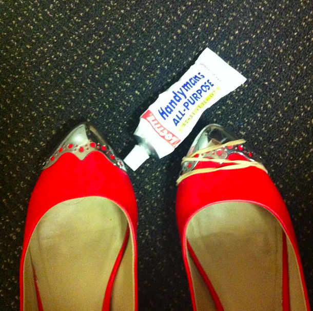 writer's pic of flat shoes with toe cap held on with rubber band while the glue sets it