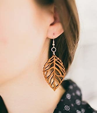 """Promising review: """"I knew wood was used to make many, many beautiful things in the world but I'd never thought about making earrings out of it. I'm glad I got these. They're really well-made and very unique-looking. They're not flashy, but very elegant and superbly carved. I love these and I'll keep an eye out for more earrings from this artist"""" —Cats & CoffeeGet them from Amazon for $19.99."""