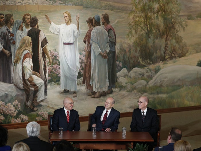 Nelson, center, with other church leaders and a mural of Jesus.