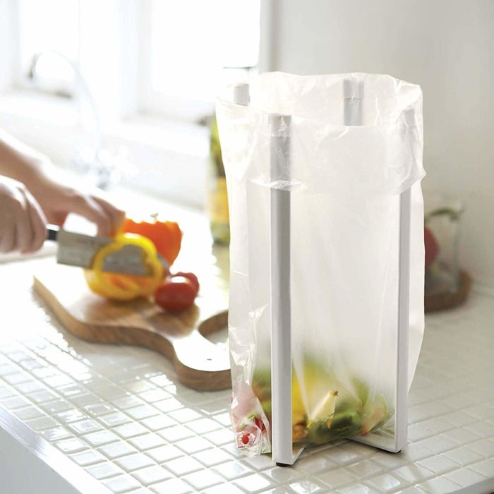 """Promising review: """"I love it most as my 'garbage bag holder' while preparing food. I also use it to hold my cutting boards, and to dry pans and cookie sheets. And oh yea, works great to dry bottles!"""" —sksGet it from Amazon for $16+ (two colors), or get a three-pack of a smaller version from Amazon for $13.99."""