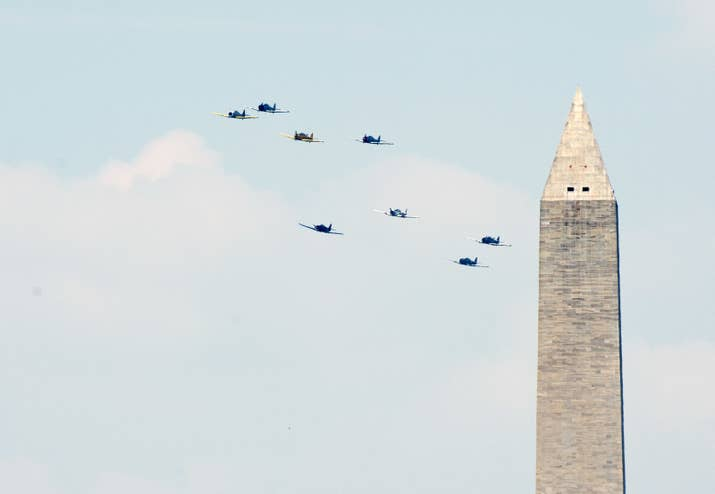 World War II era planes fly down the National Mall in 2015.