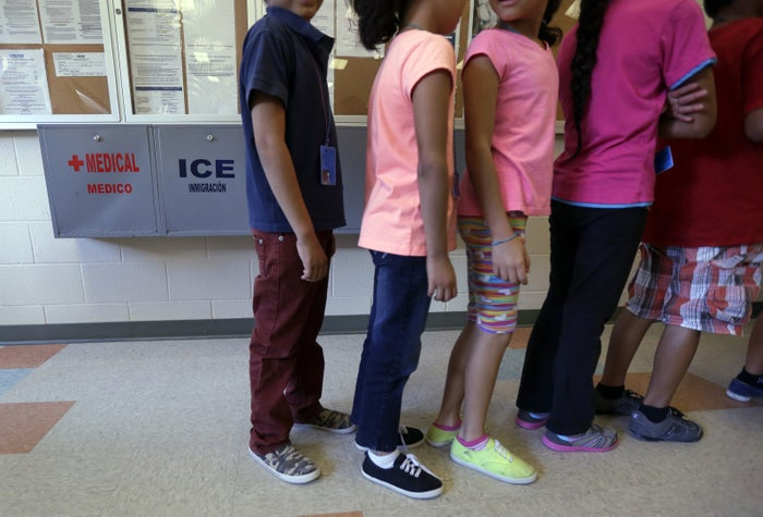 Detained immigrant children line up in the cafeteria at the Karnes County Residential Center.