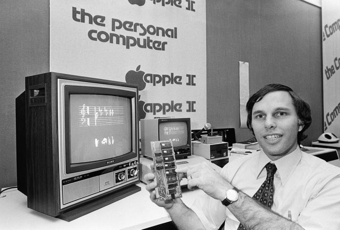 Joel Skolnick, a computer store manager in Cambridge, Massachusetts, displays a memory board of an Apple II computer on Nov. 15, 1978.