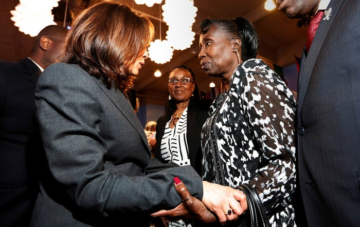 Harris with Sequita Thompson, grandmother of police shooting victim Stephon Clark, at a town hall meeting in April.