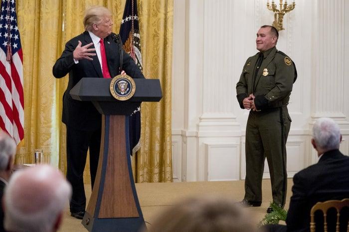 President Donald Trump welcomes Customs and Border Patrol agent Adrian Anzaldua.