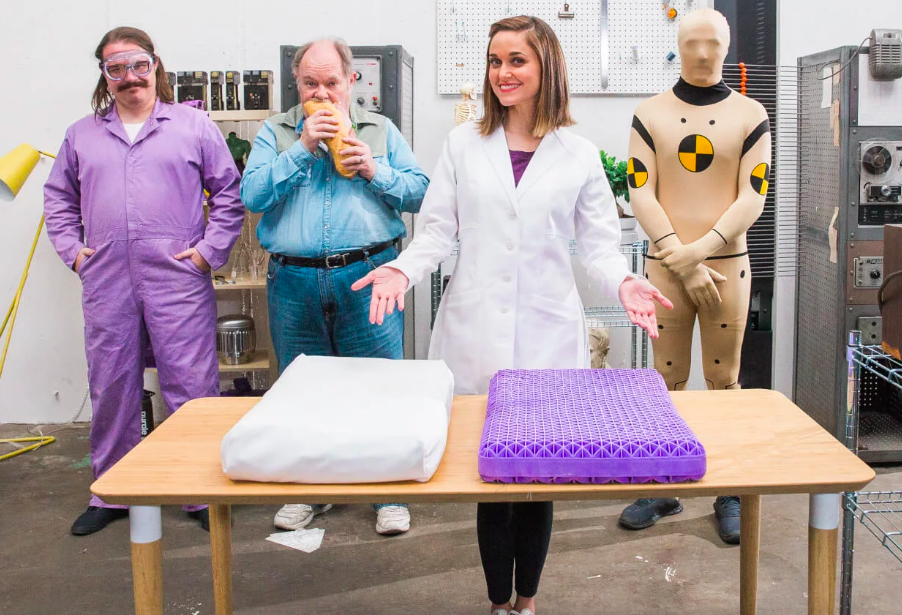 A funny shot of the pillow being displayed inside a testing lab. The pillow is displayed with a case and without, showing the geometric purple fill used to shape it.