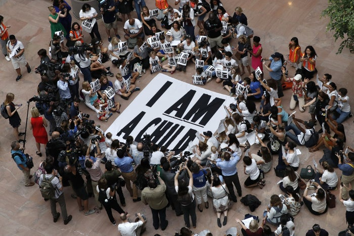 Families with young children protest the separation of immigrant families with a sit-in at the Hart Senate Office Building in Washington, DC, on July 26, 2018.