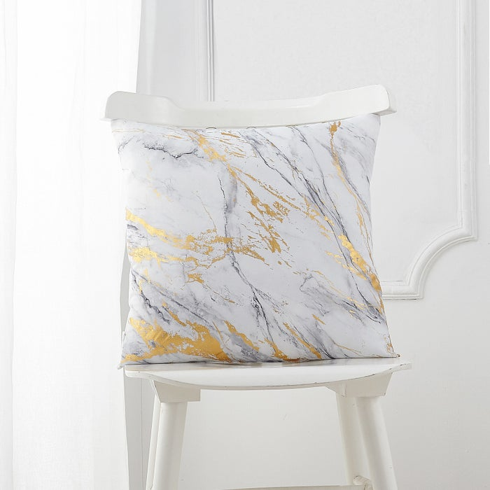 """Promising review: """"Extremely beautiful!!! The detailed gold foil is expertly applied, the blue marbling looks amazing, and the pillows still look very new after I bought them months ago. I originally bought two of the blue version but since they were so pretty I had to get two more (even though we really don't need more pillows)! They're just that lovely. These very easily complement many different pieces of furniture that we own."""" —MelGet it from Walmart for $10+ (available in white and blue)."""