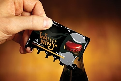 A person using the credit-card sized multi-tool to open a glass bottle cap