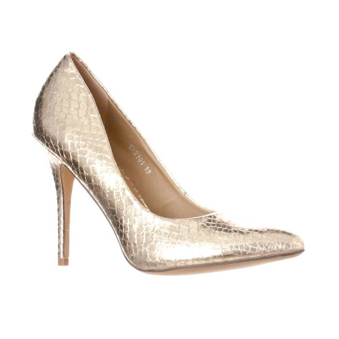 ddc4f61d1b89 A pair of snakeskin pumps that will make you look like a million bucks for  a fraction of the cost.