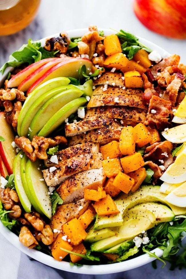 Topped with avocado, bacon, sliced apple, walnuts, feta, and chicken, this filling salad is worthy of a standalone dinner. Get the recipe.