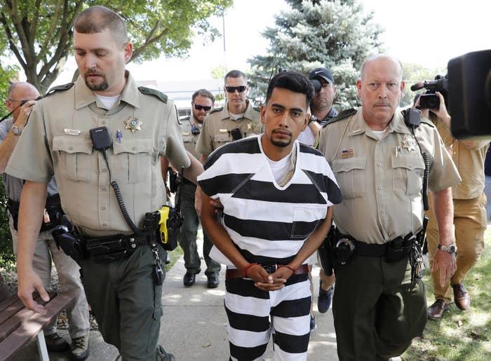 Cristhian Bahena Rivera is escorted into the Poweshiek County Courthouse on Wednesday.