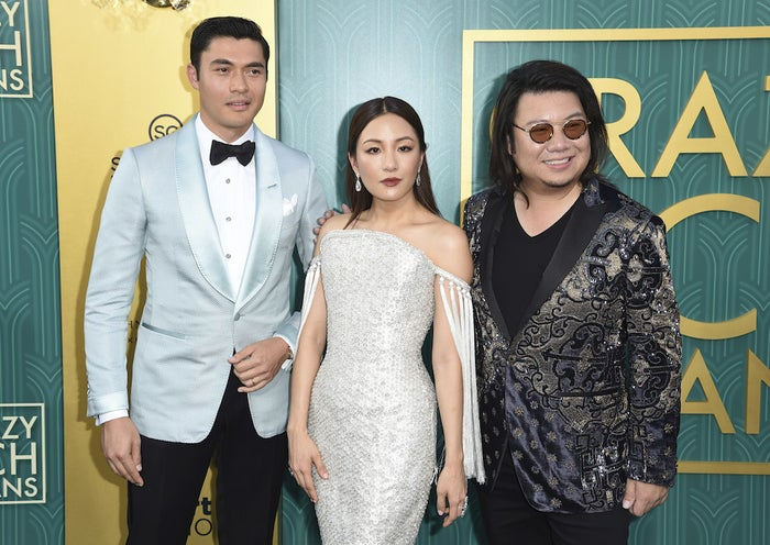 From left: Henry Golding, Constance Wu, and executive producer and author Kevin Kwan arrive at the premiere of Crazy Rich Asians at the TCL Chinese Theatre on Tuesday, Aug. 7, 2018, in Los Angeles.