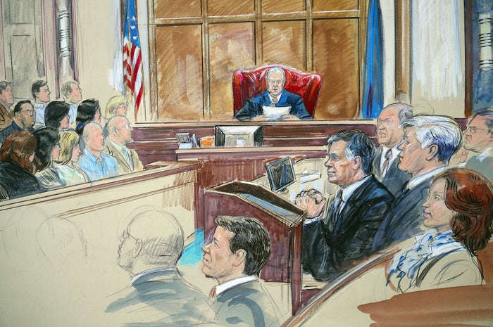 A sketch showing Paul Manafort, clasping his hands as he listens to US District Court Judge T.S. Ellis III at federal court in Alexandria, Virginia, Aug. 21, 2018.