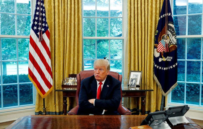 President Donald Trump reacts to a question during an interview with Reuters in the Oval Office of the White House on Aug. 20.