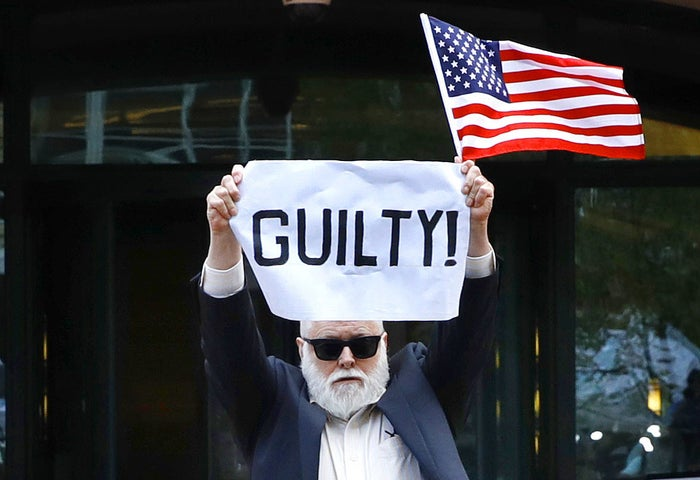 "Protester Bill Christeson holds up a sign saying ""GUILTY!"" as the first guilty count comes in at the trial of former Donald Trump campaign chair Paul Manafort, at federal court in Alexandria, Virginia, on Aug. 21."