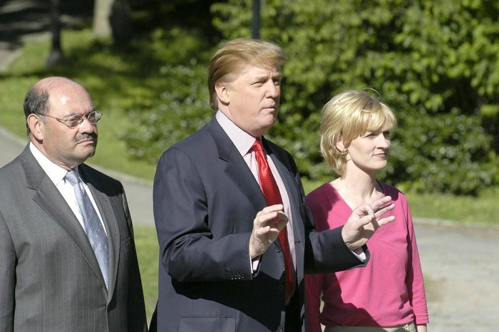 Weisselberg (left) with Trump and The Apprentice's Carolyn Kepcher