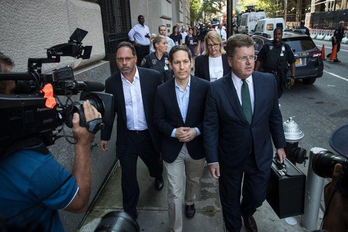 Tom Frieden (center) exits Brooklyn Criminal Court.