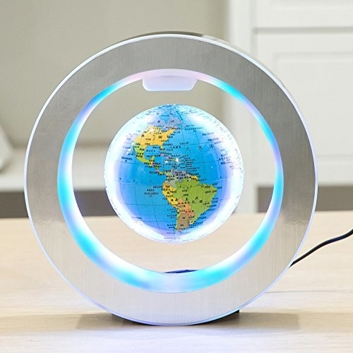 A circular light with a floating globe in the center of it. The globe floats with magnets and the lights on the inside and outside of the circle glow when plugged in.