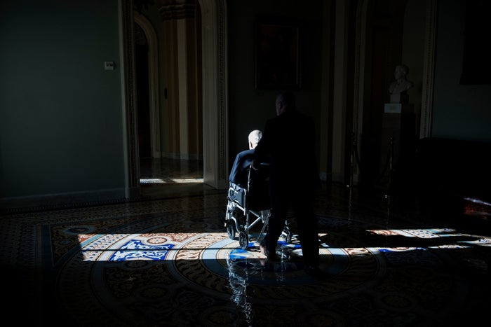Sen. McCain uses a wheelchair on Capitol Hill in December 2017.