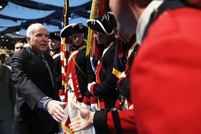 Sen. John McCain greets Army color guards after being presented with the Outstanding Civilian Service Medal in Arlington, Virginia, on Nov. 14, 2017.