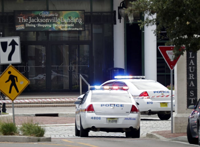Police cars block off a street near the scene of a mass shooting at Jacksonville Landing in Jacksonville on Sunday.
