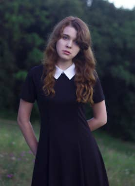 fa715b8142 7. A knee-length collar dress (that the Addams Family would approve of in  black), which is clearly made for wearing on a Wednesday.