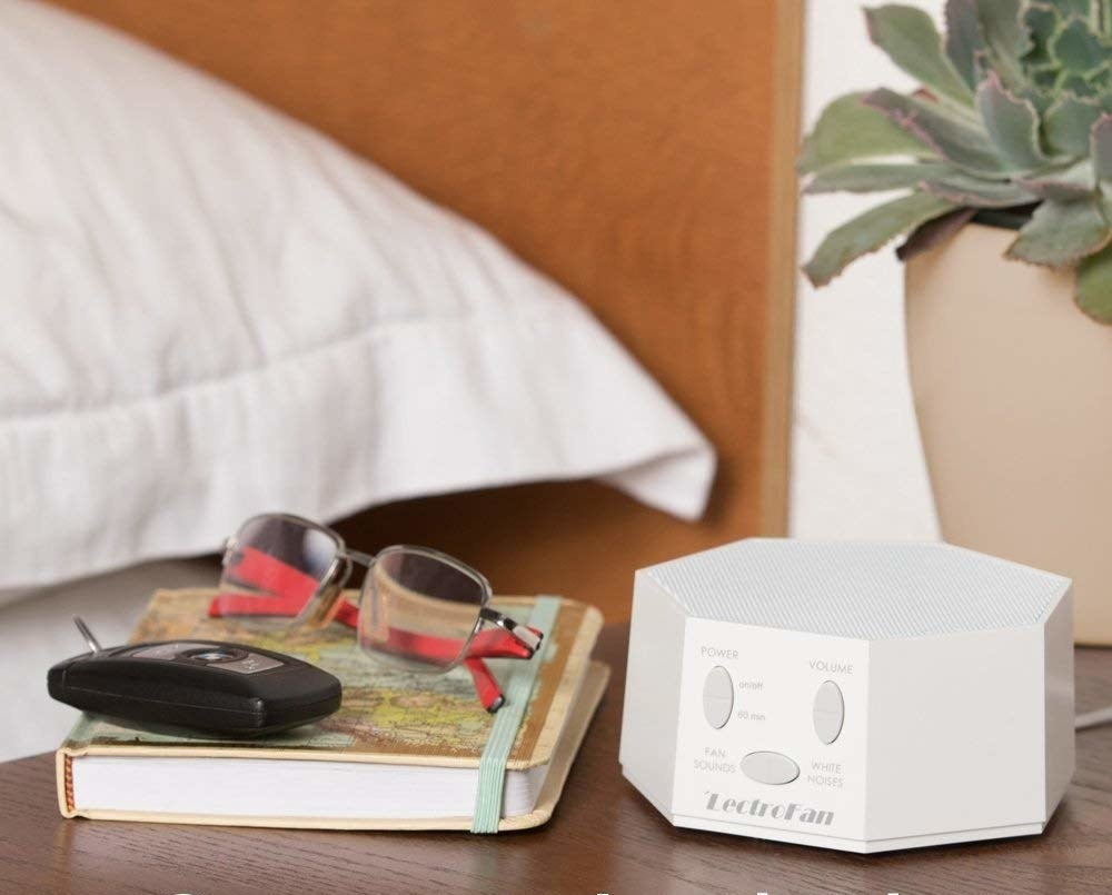 """Promising review: """"I've been using this noise machine for about a month and I'm very happy with it; I've been sleeping far better than I ever have before. I even use it to avoid disturbing my roommate when I watch TV or play games at night because, properly positioned, it screens out those noises from others without overriding what I need to hear. Highly recommend this product!"""" —Josh NorrisGet it from Amazon for $49.95 (available in two colors)."""