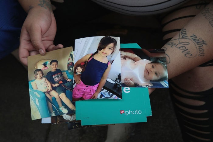 Amber Ayala looks through pictures of her brothers and sisters who were killed in an early-morning fire in the Little Village neighborhood on Aug. 26.