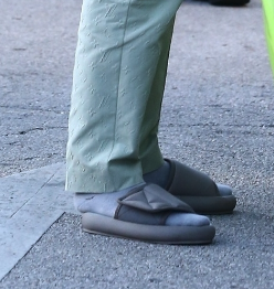 Yes, Kanye wore this outfit to a wedding.