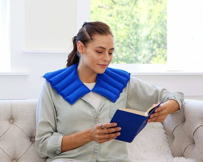 """Promising review: """"This product is fantastic and precisely what I was searching for. There were many other options, but the rave reviews on this one sold me. I'll start with the design....it warms both my shoulders and neck all in one swoop and is great for relieving stress and tension. The design leaves me able to walk around with it draping over my shoulders, and sitting upright in my office chair for work. Other neck wrap styles I've had in the past left me with having to stay put and propped up on the couch."""" —shellynn9876Get it from Amazon for $16.79+."""