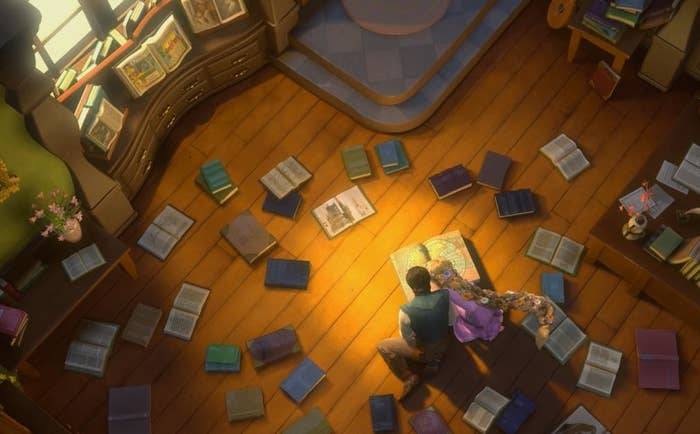 Moving along to Rapunzel's own movie, when Rapunzel visits the village, she can be seen sitting on the floor in a library together with Flynn, surrounded by books. If you take a closer look, these books bare the titles of some of our favorite classic Princess tales, including Sleeping Beauty and The Little Mermaid.