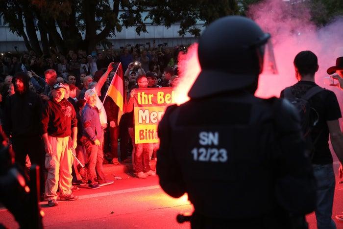 Police watch far-right demonstrators on Monday in Chemnitz.