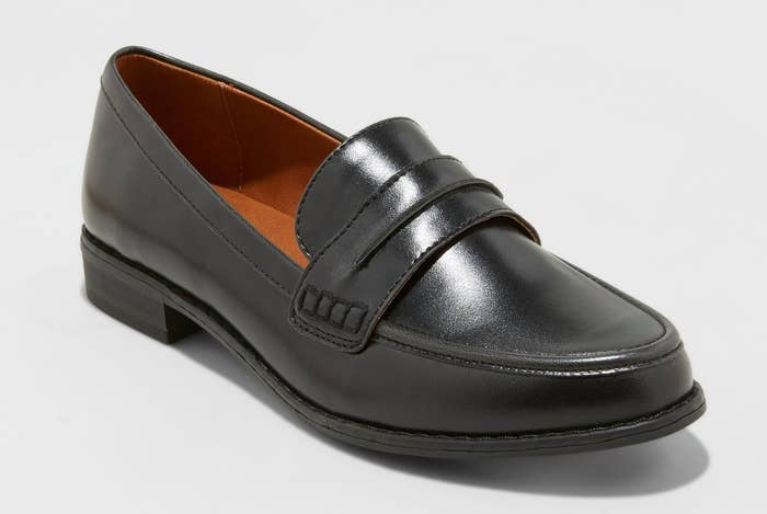 """Promising review: """"Oh how I love a beautiful loafer! I HAD TO HAVE THEM. These run large and comfy. I'm a 7.5 in every shoe I wear. I also have a wide foot (flat feet) and loafers normally don't fit my wide feet well. These are beautiful but they do run large. My feet didn't feel tight in them at all — and I had to size DOWN from my normal 7.5 to a size 7. I wasn't wearing socks (and don't with my loafers) so that is something to consider. I was so surprised they fit so loose. They are sturdy, shiny, soft, just a great classic looking loafer and have a nice classic look to them (not too fancy, more relaxed style that can be dressed up or down). Have been looking for something like this FOR AGES! Just be aware they run a bit loose."""" —liblady0524Price: $27.99 (available in sizes 5-12 and in black and brown)"""