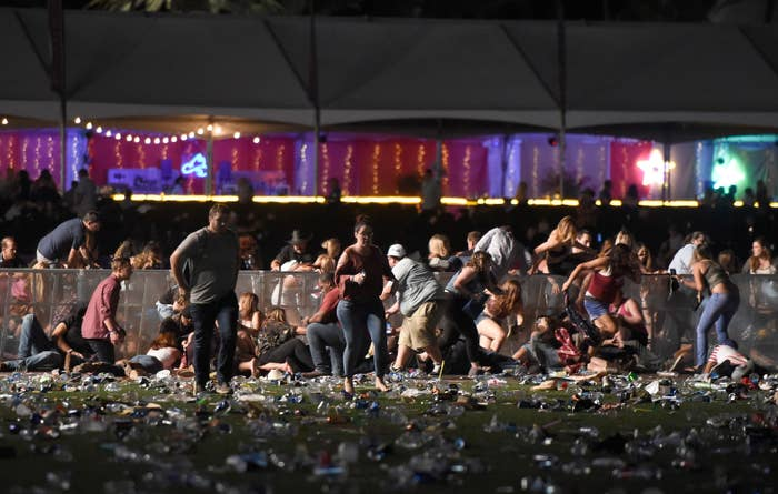 People flee the Route 91 Harvest country music festival after gunfire erupted on Oct. 1, 2017.