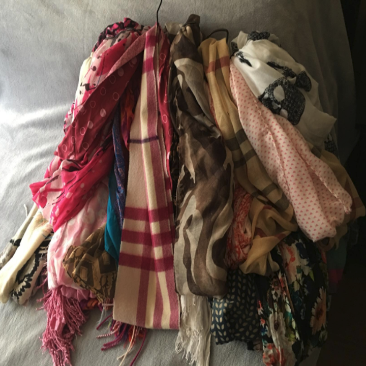 Reviewer photo of before using the scarf hanging with a bunch of random scarves all in a mess on a hanger