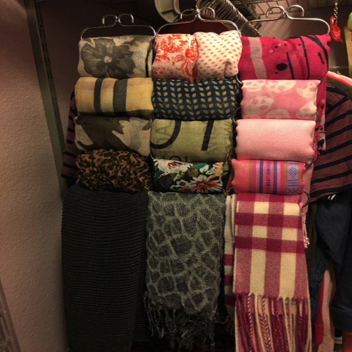 The same scarves but now neatly folded and organized on the hanger