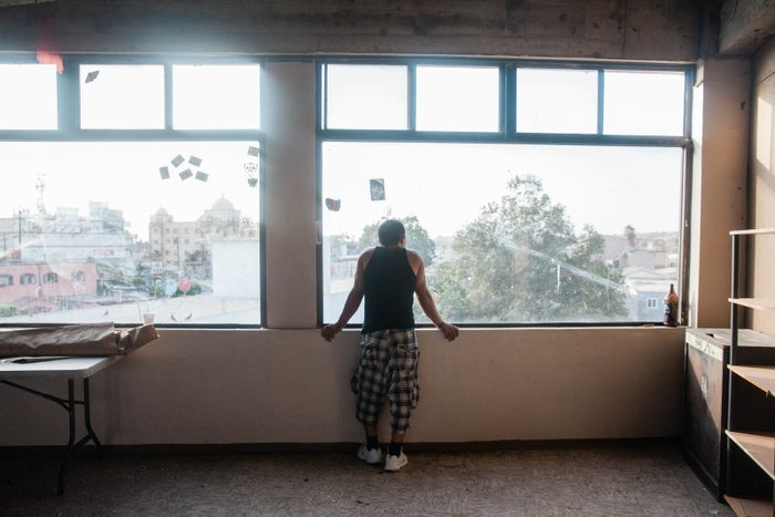 One of the attendees at a workshop for new immigrants looks out at Tijuana.