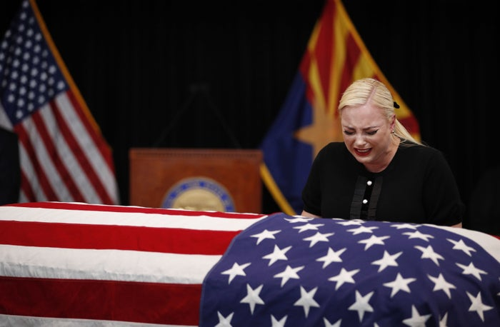 Meghan McCain, daughter of Sen. John McCain, touches the casket during a memorial service at the Arizona capitol, on Aug. 29 in Phoenix.