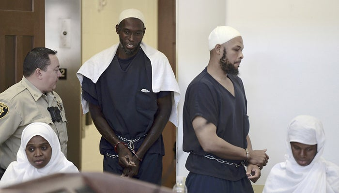 From left: Hujrah Wahhaj, Lucas Morton, Siraj Wahhaj, and Subbannah Wahhaj enter District Court in Taos, New Mexico.