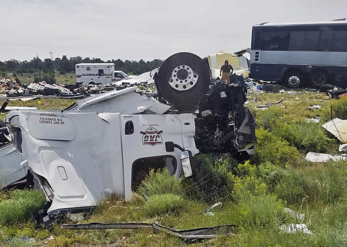 First responders work at the scene of the collision Thursday.