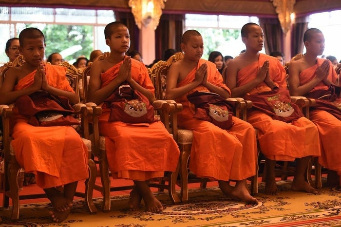 Dressed in traditional orange robes with bare feet at a ceremony on Saturday, 11 members of the Wild Boars soccer team clutched bags embroidered with their team mascot. One boy wasn't ordained as a monk because he is not Buddhist.