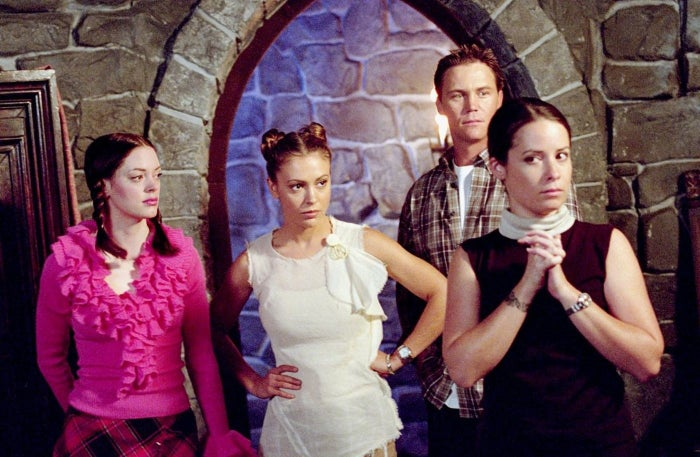Rose McGowan as Paige Matthews, Alyssa Milano as Phoebe Halliwell, Brian Krause as Leo Wyatt, and Holly Marie Combs as Piper Halliwell in the original Charmed.