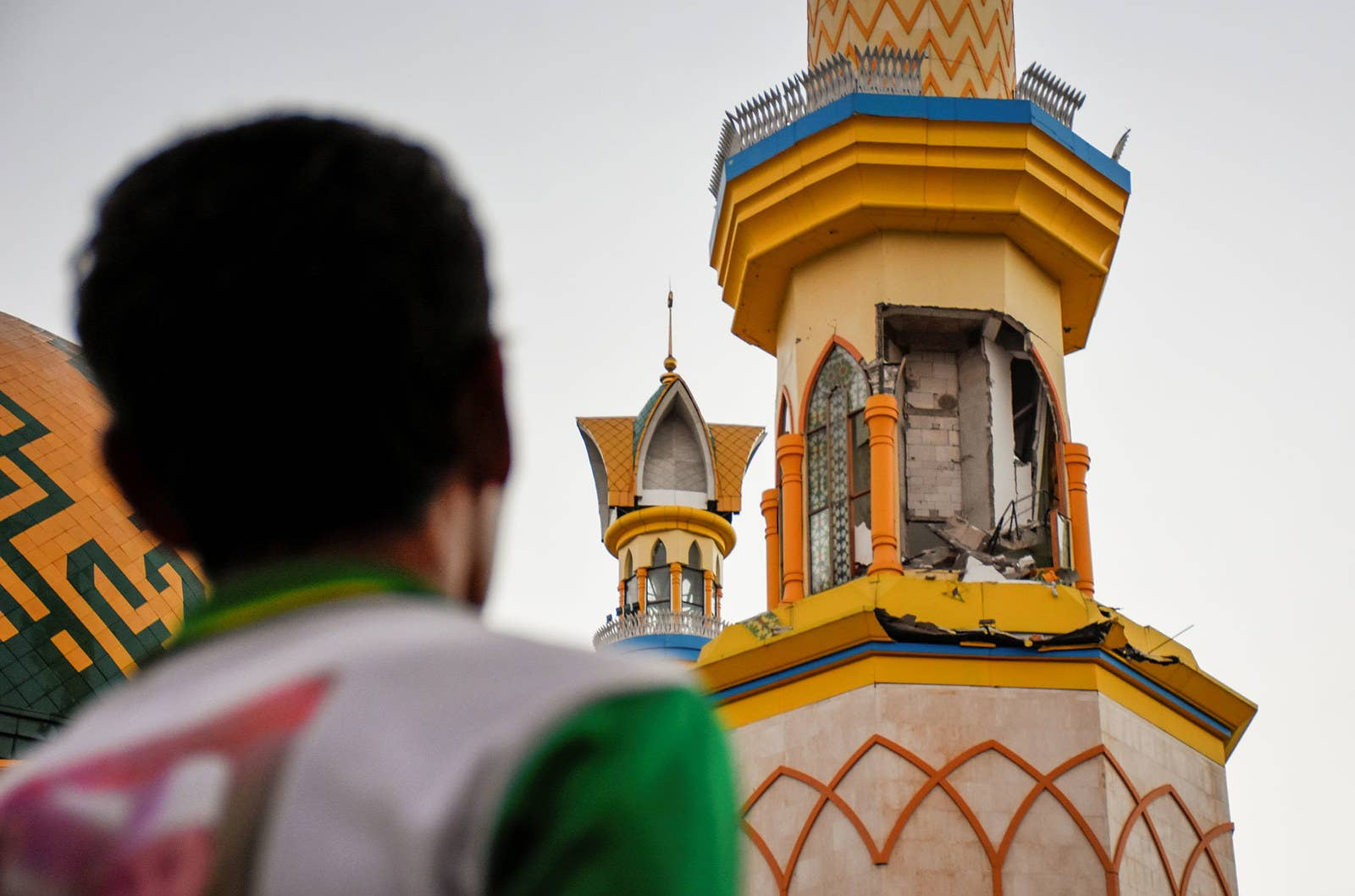 A man looks at damage to a mosque in Mataram following the strong earthquake on Lombok.
