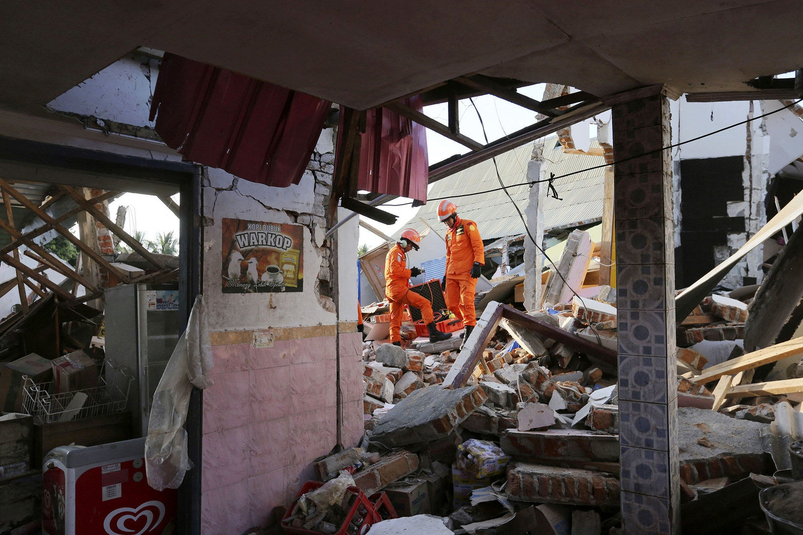Rescue teams search for victims in the rubble.