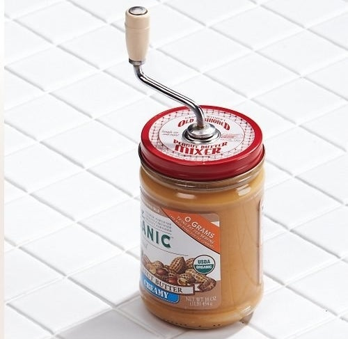 """Made of chrome-plated steel that is FDA-approved, BPA-free, and designed to fit on 16 oz. jars with 3 in. lids. To clean, hand wash all parts with warm, soapy water.Promising review: """"Peanut butter with oil at the top can be annoying, to say the least. I love oily nutritious peanut butter, and Mess Free Nut Stirrer solves that problem. Easy to use, and is sold with different size caps to fit most jars. Put it all together, give it a good stir, then remove the rod, which is self-cleaning, and remove the cover to enjoy your nut butter."""" —Ed SchwartzGet it from Amazon for $9.99+ (available in three sizes)."""